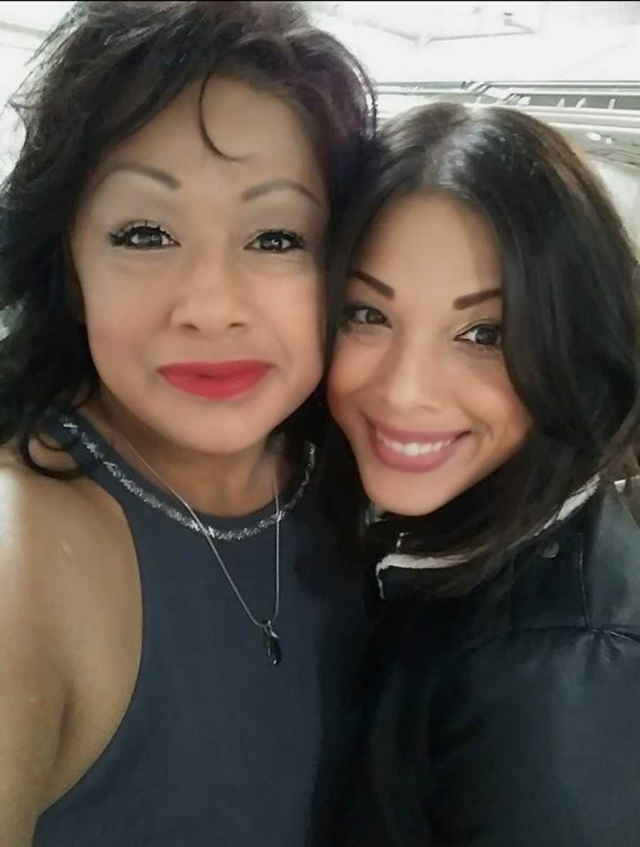 mom and daughter smiling for picture
