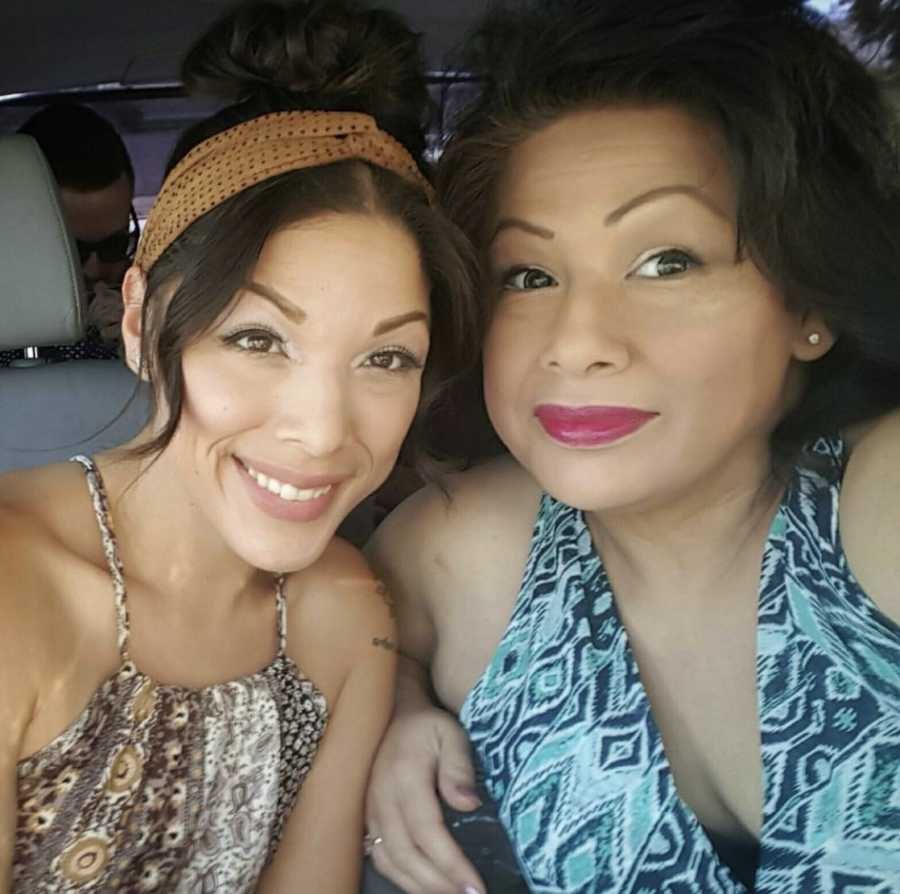Mom and daughter, made up and smiling in car