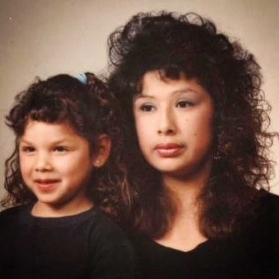 mom and daughter in the 1980s smiling for posed picture