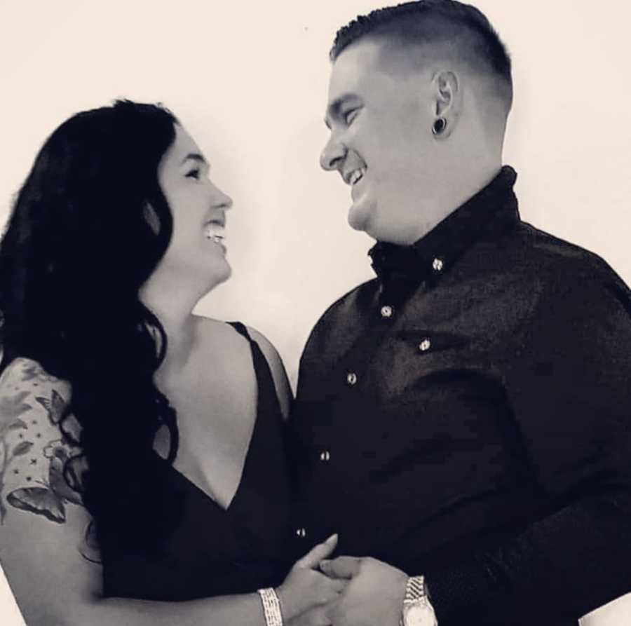 husband and wife smiling at each other