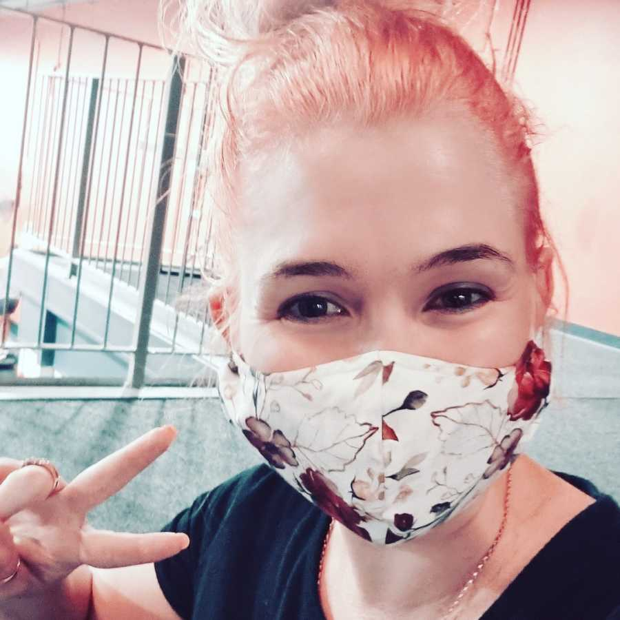 woman taking a selfie in a mask