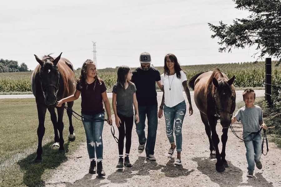 Family photo riding horses