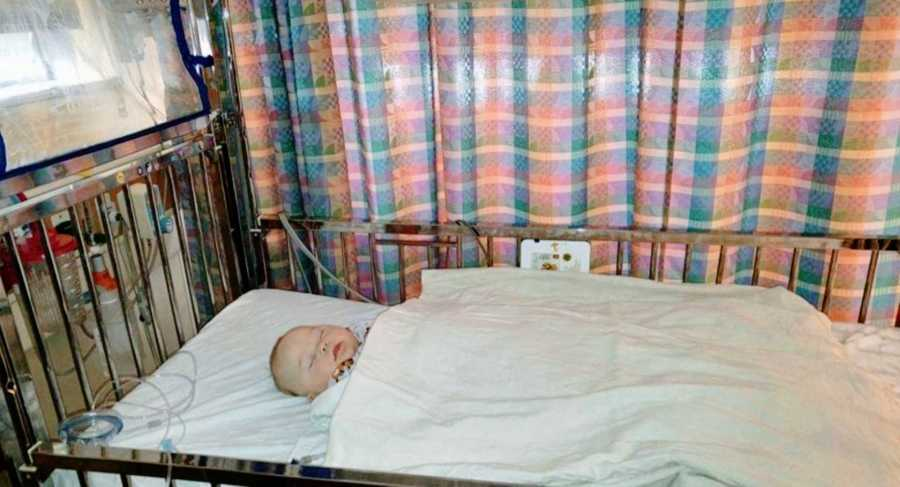 A young boy with down syndrome lies down in the hospital during testing