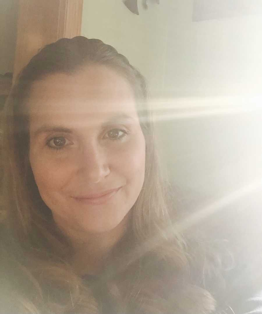 woman smiling, sunlight coming in