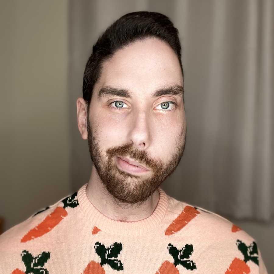 Selfie of man in sweater
