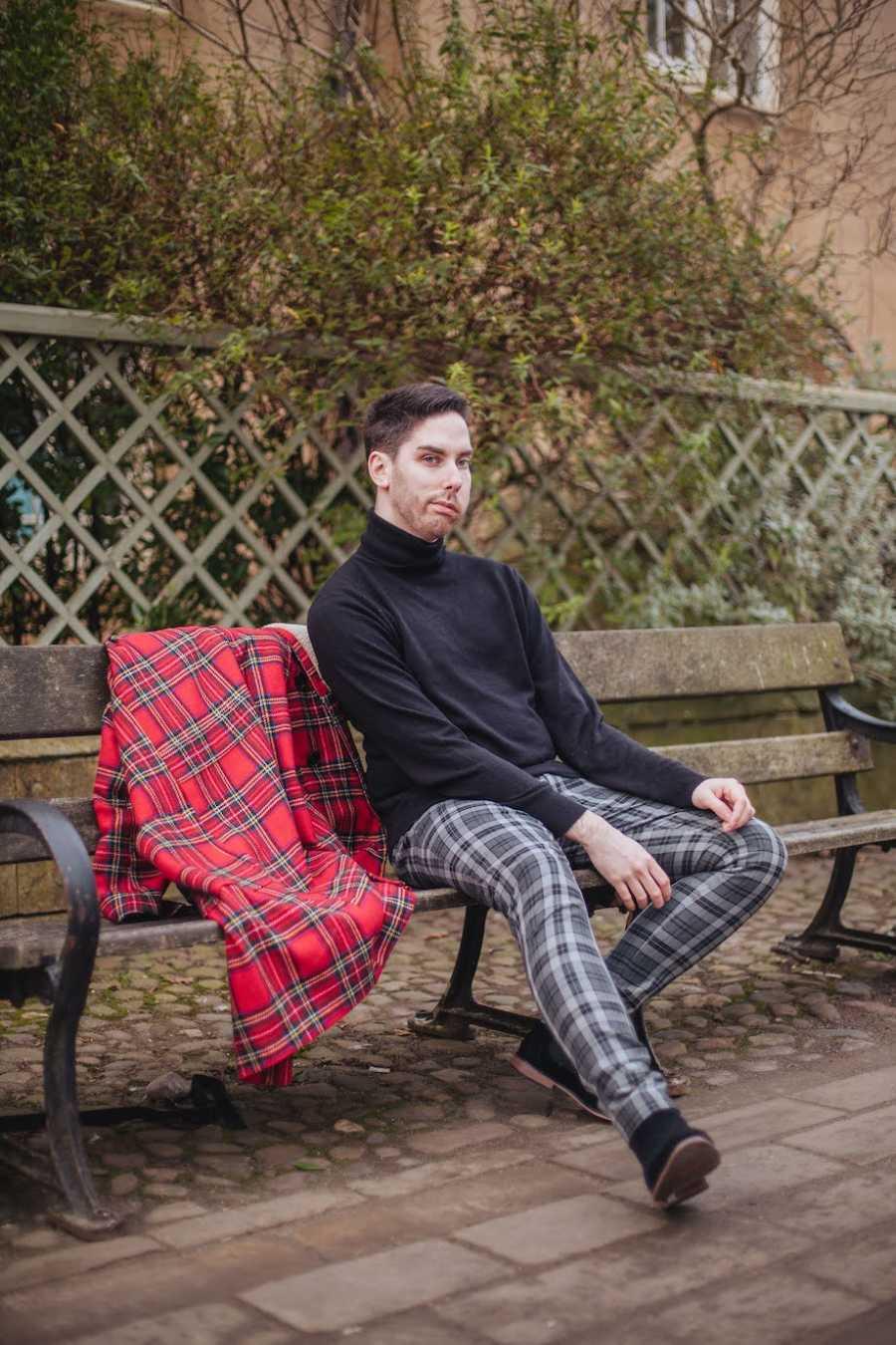Scottish man sitting on bench
