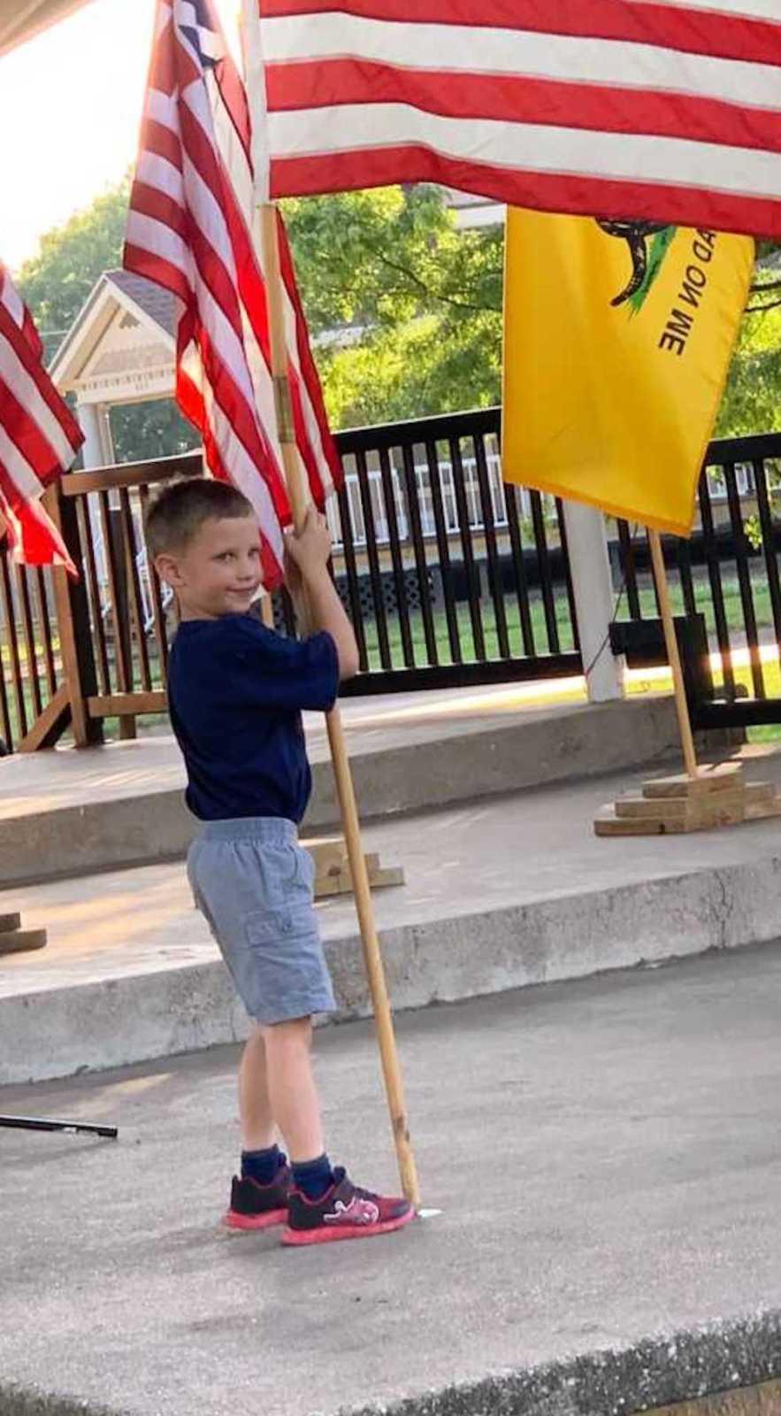 A little boy with a flag