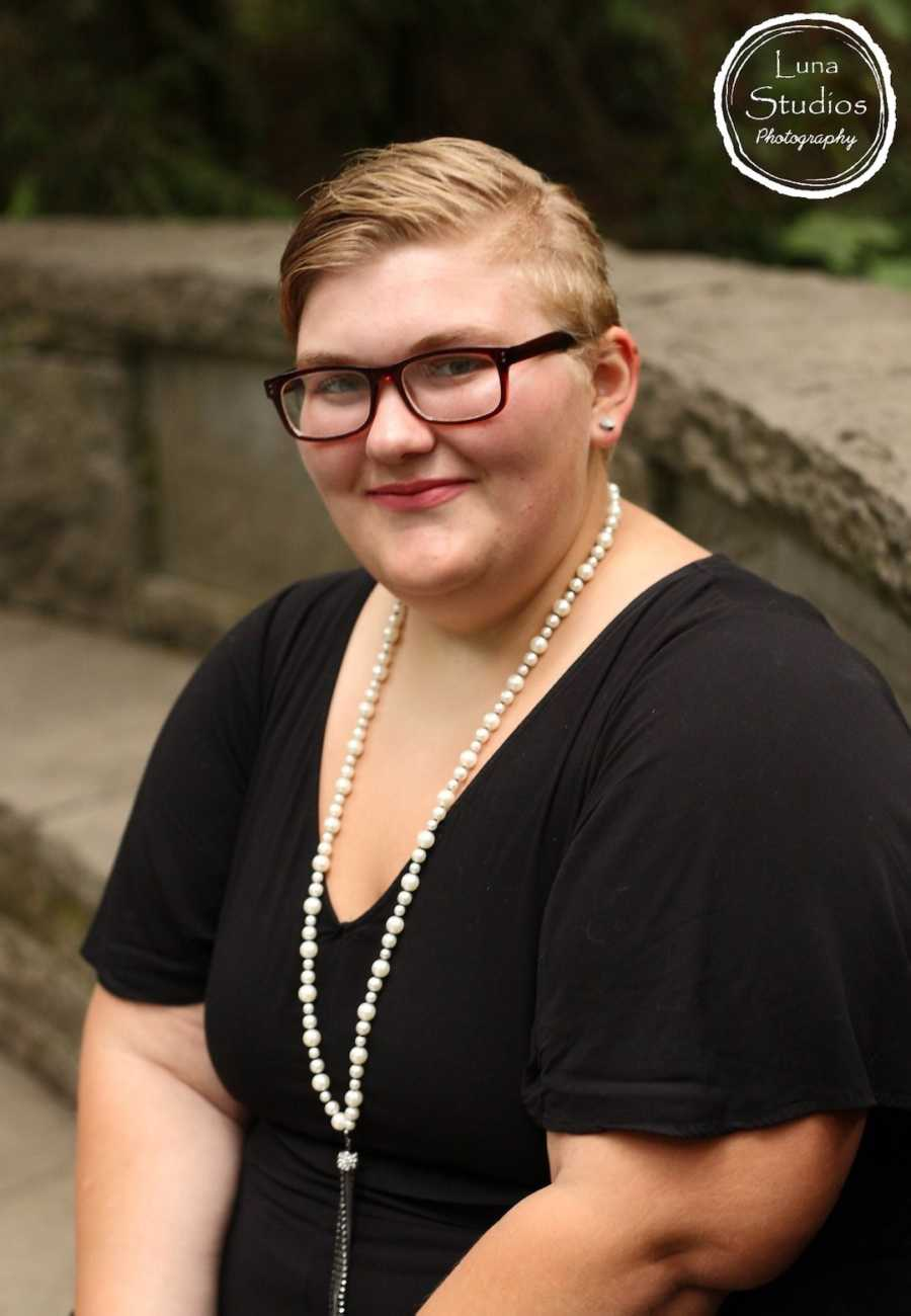 Woman posing with pearl necklace and glasses