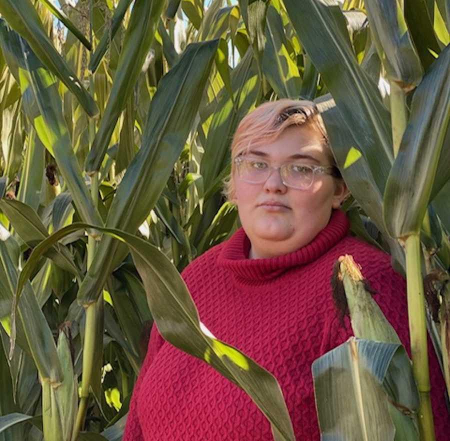 Woman posing in field