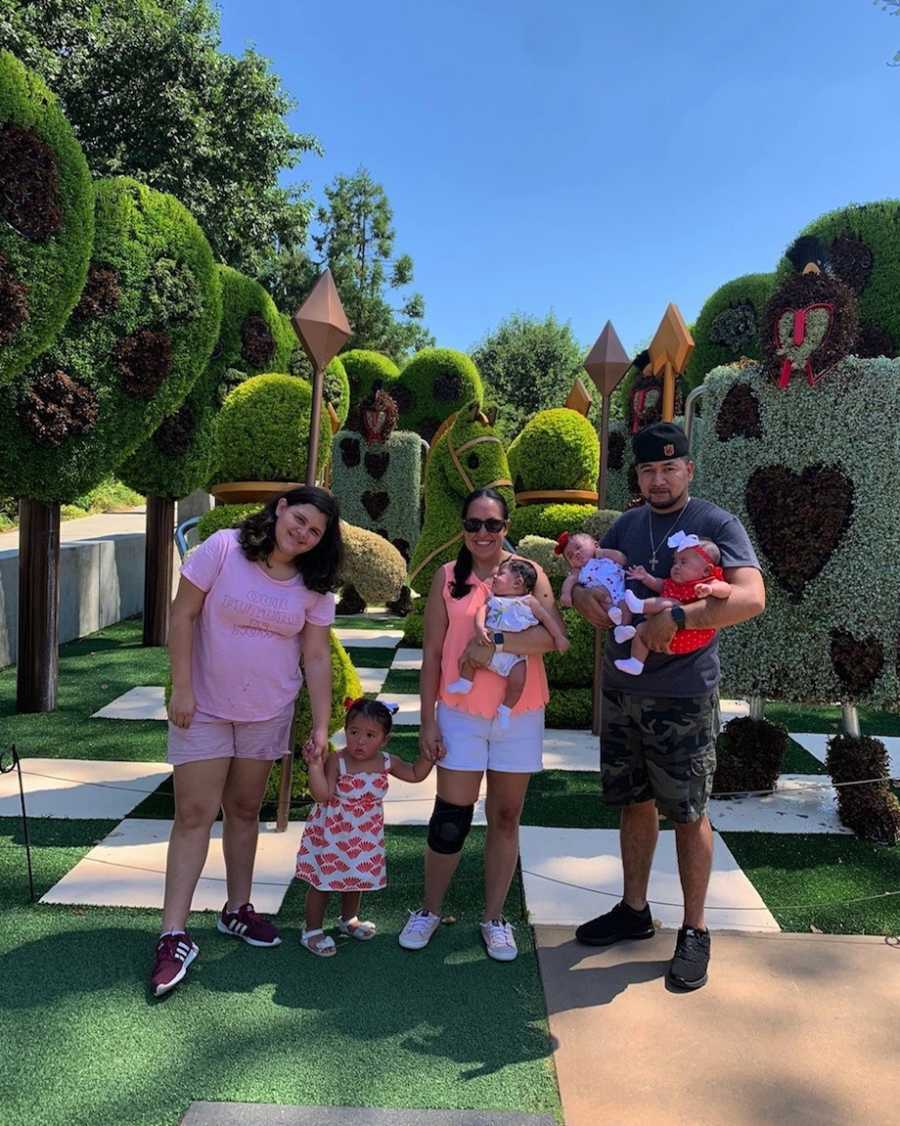 Family photo at Disney with triplets