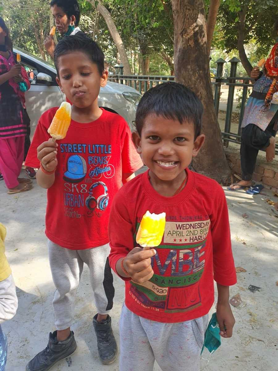 Adopted kids eating popsicles