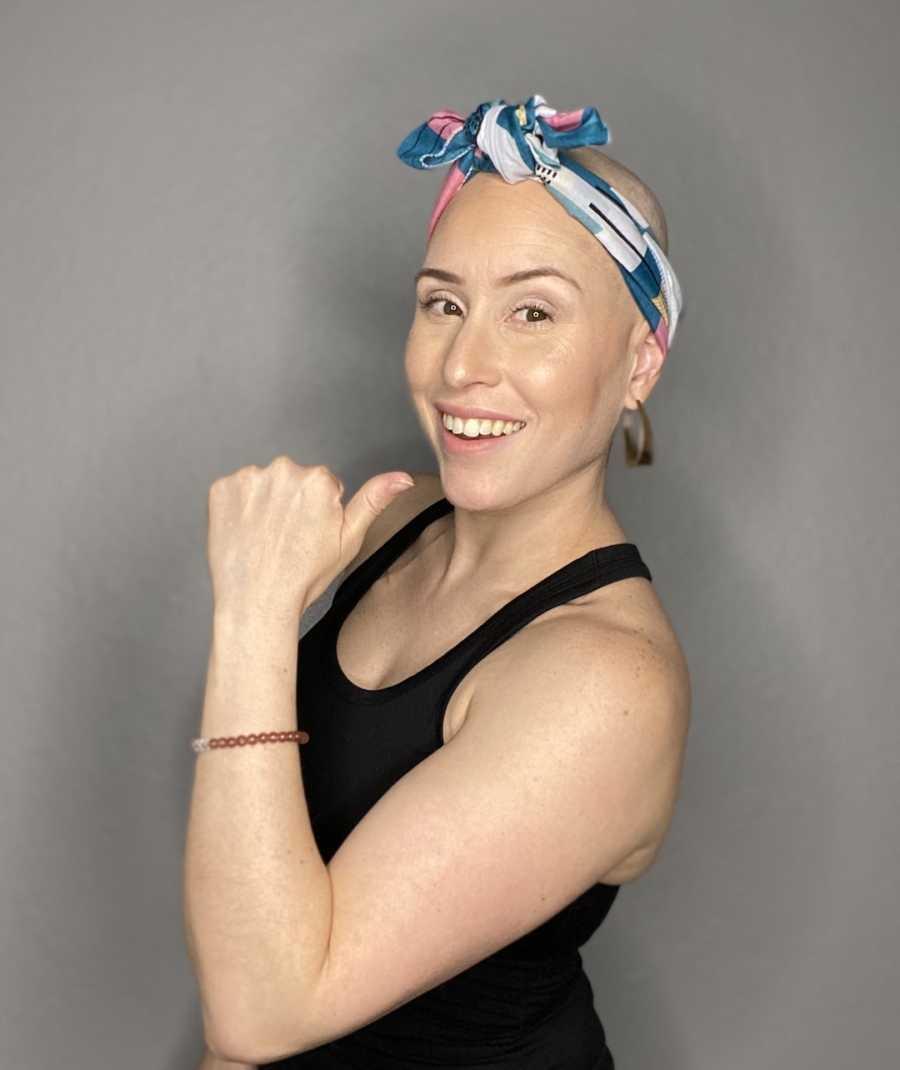 bald woman with bandana around her head