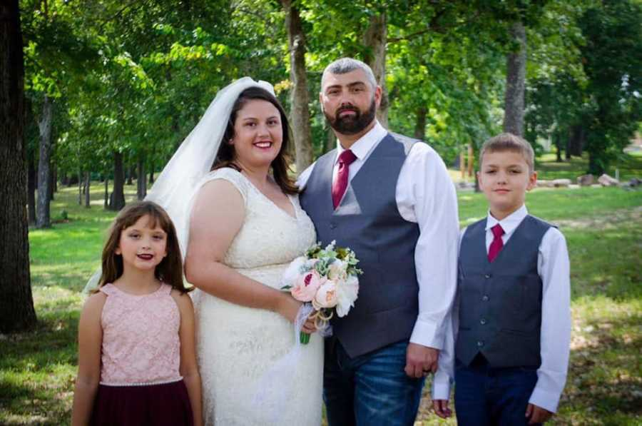 bride and groom with family on wedding day