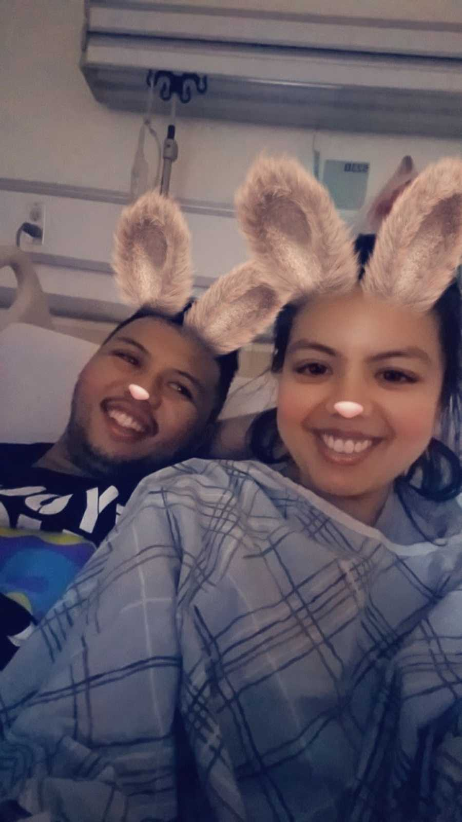 couple smiling with a snapchat filter on