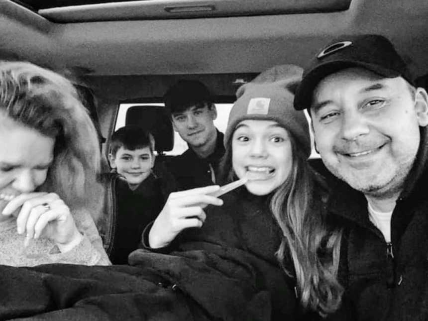 Family of five take a candid car selfie with going on a roadtrip