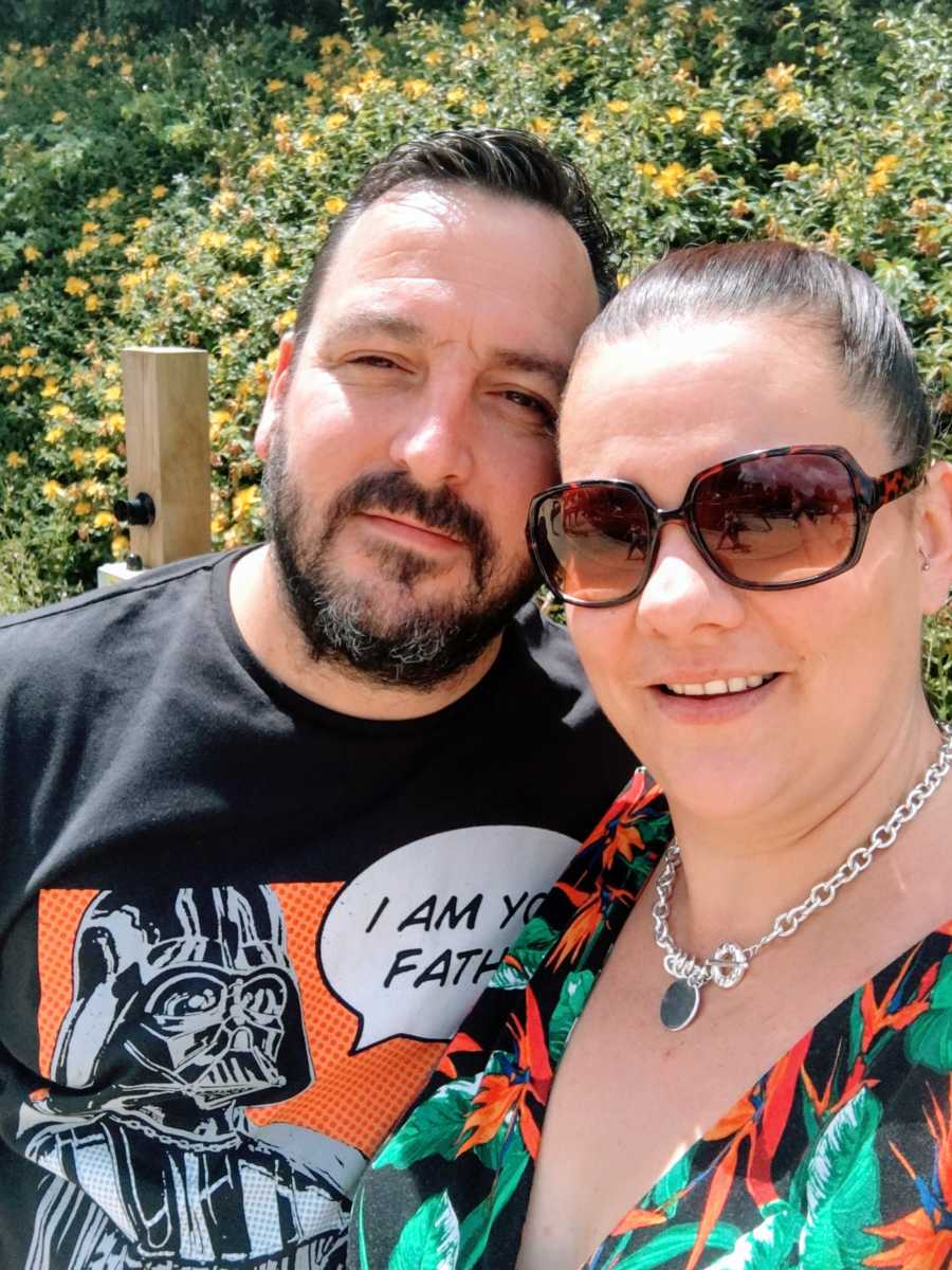 """Couple take selfie outside, husband wearing a popart Darth Vader """"I am your father"""" shirt"""