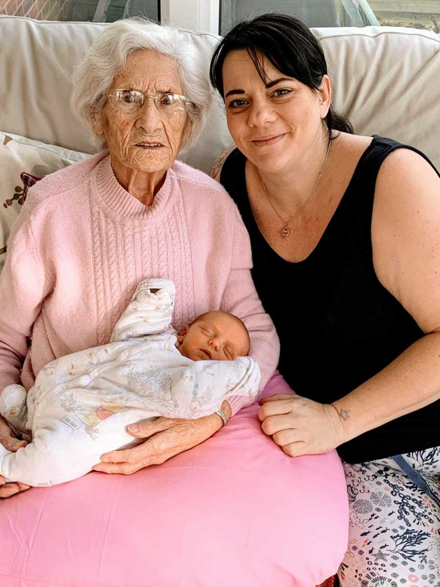 Woman poses with her grandmother and her newborn baby boy