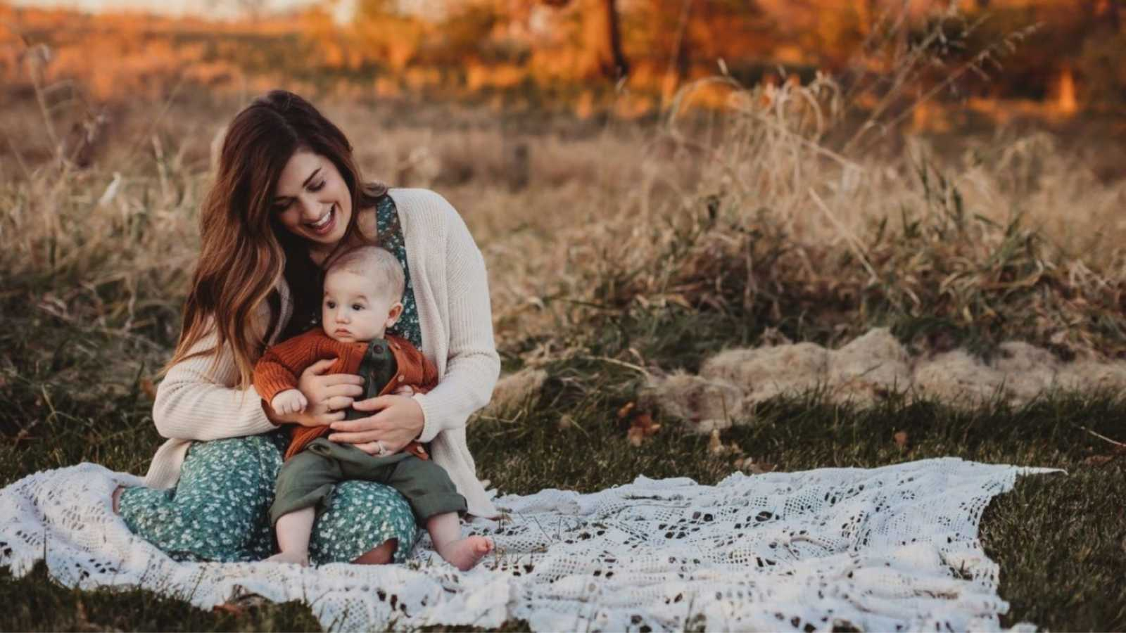 Mom holds her baby son during a beautiful Boho-themed photoshoot