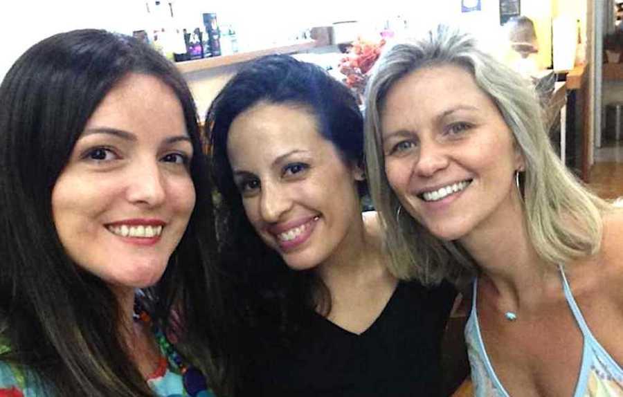 Women smiling for selfie