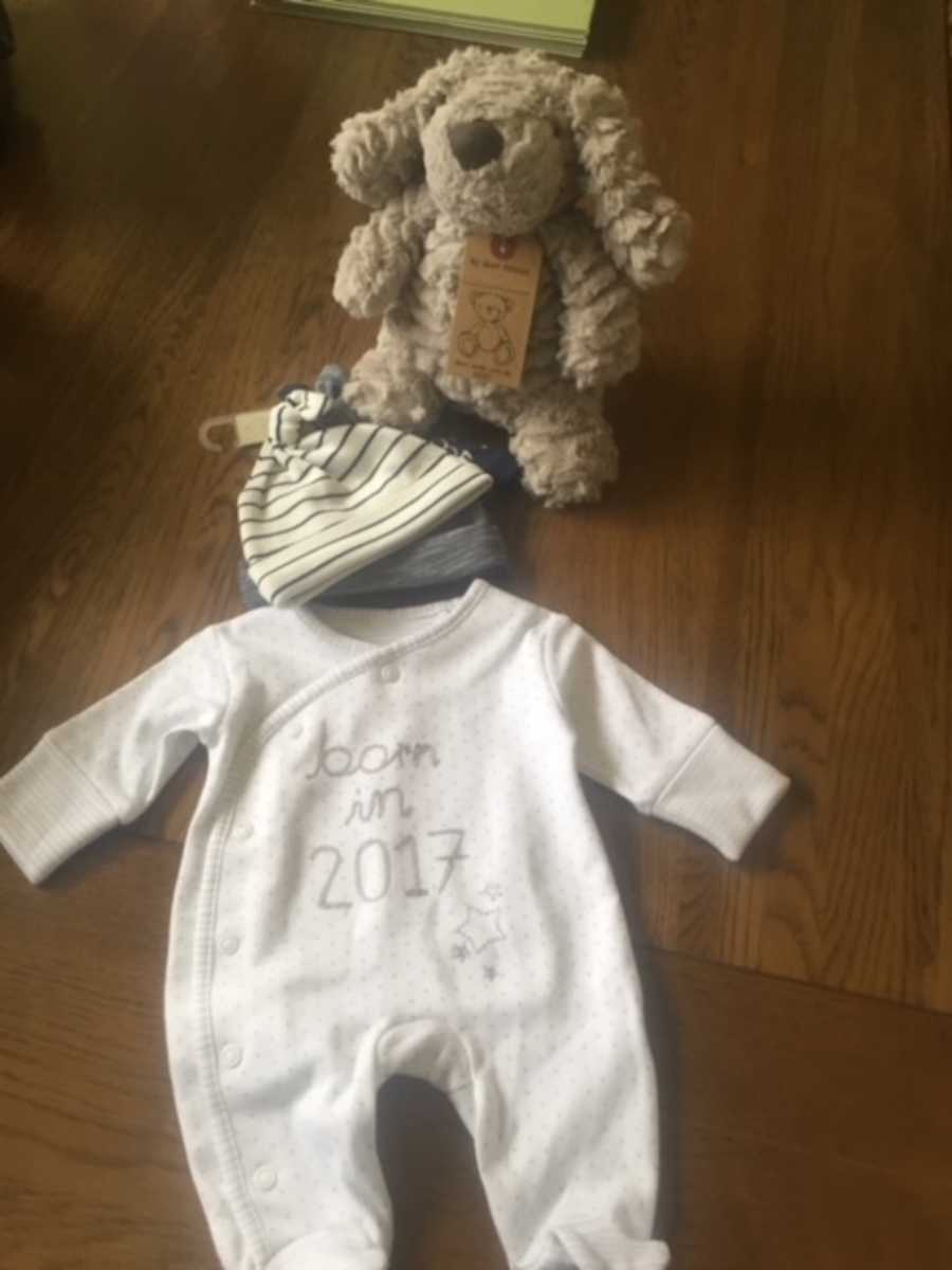 Baby clothes and stuffed animal