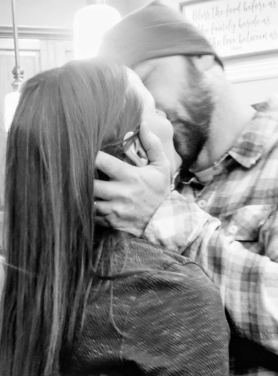 Husband passionately kisses his wife like a scene out of The Notebook