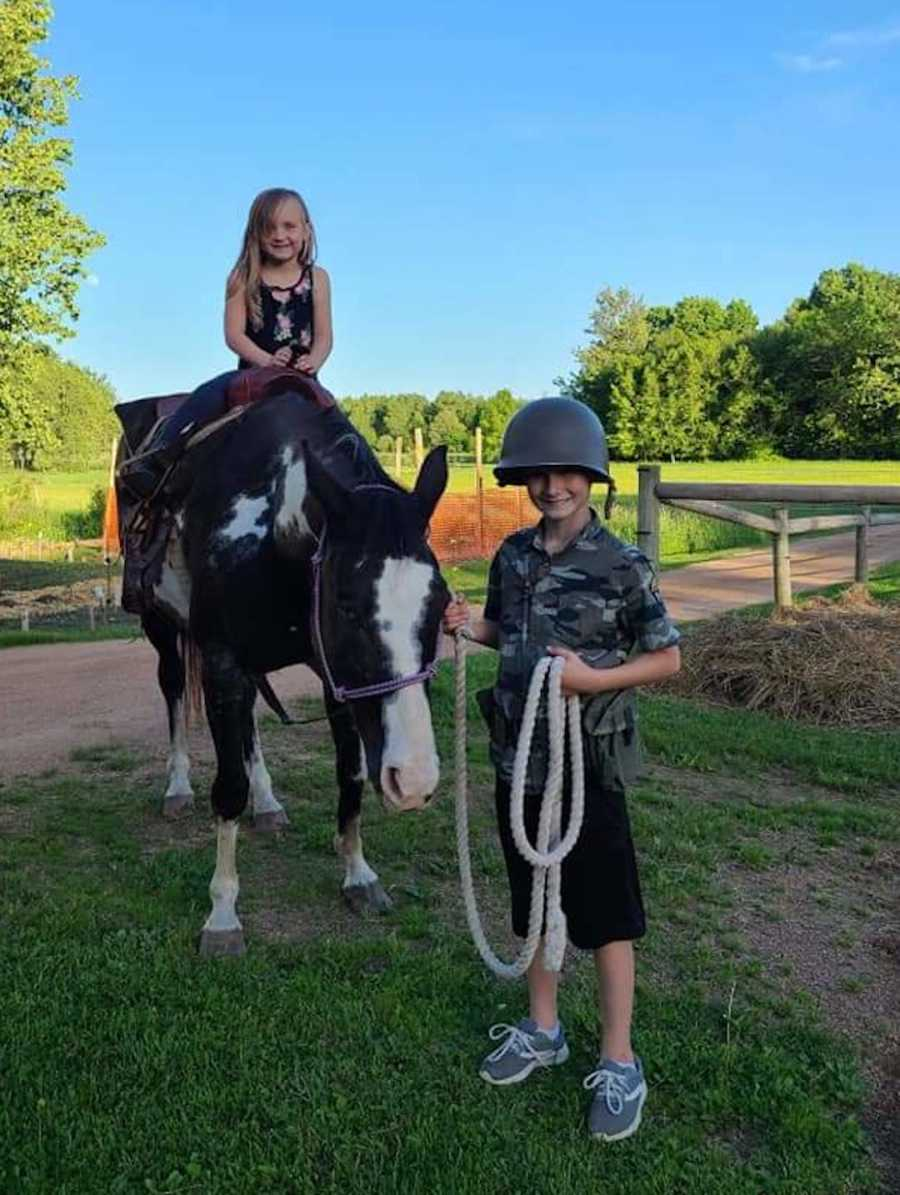 sister on horse with brother