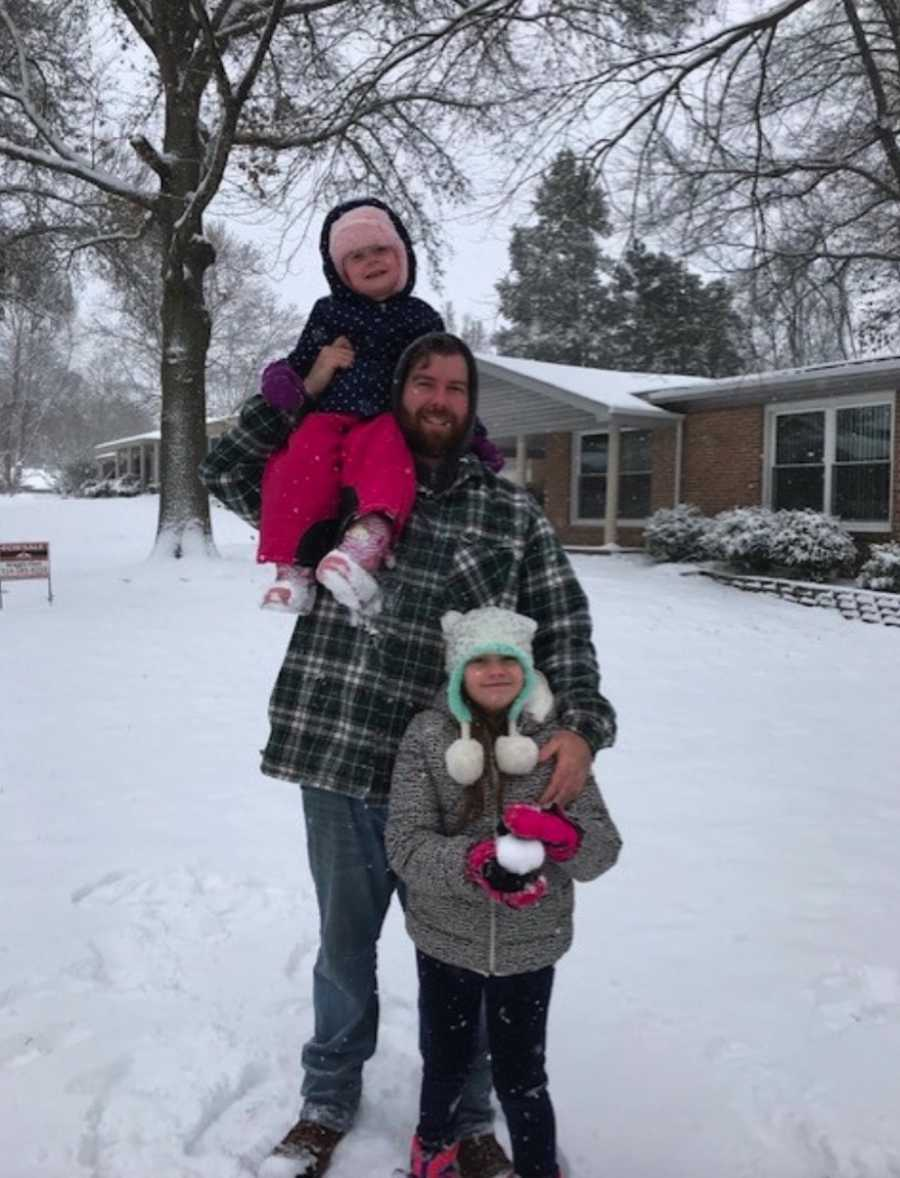 Dad with two daughters in snow