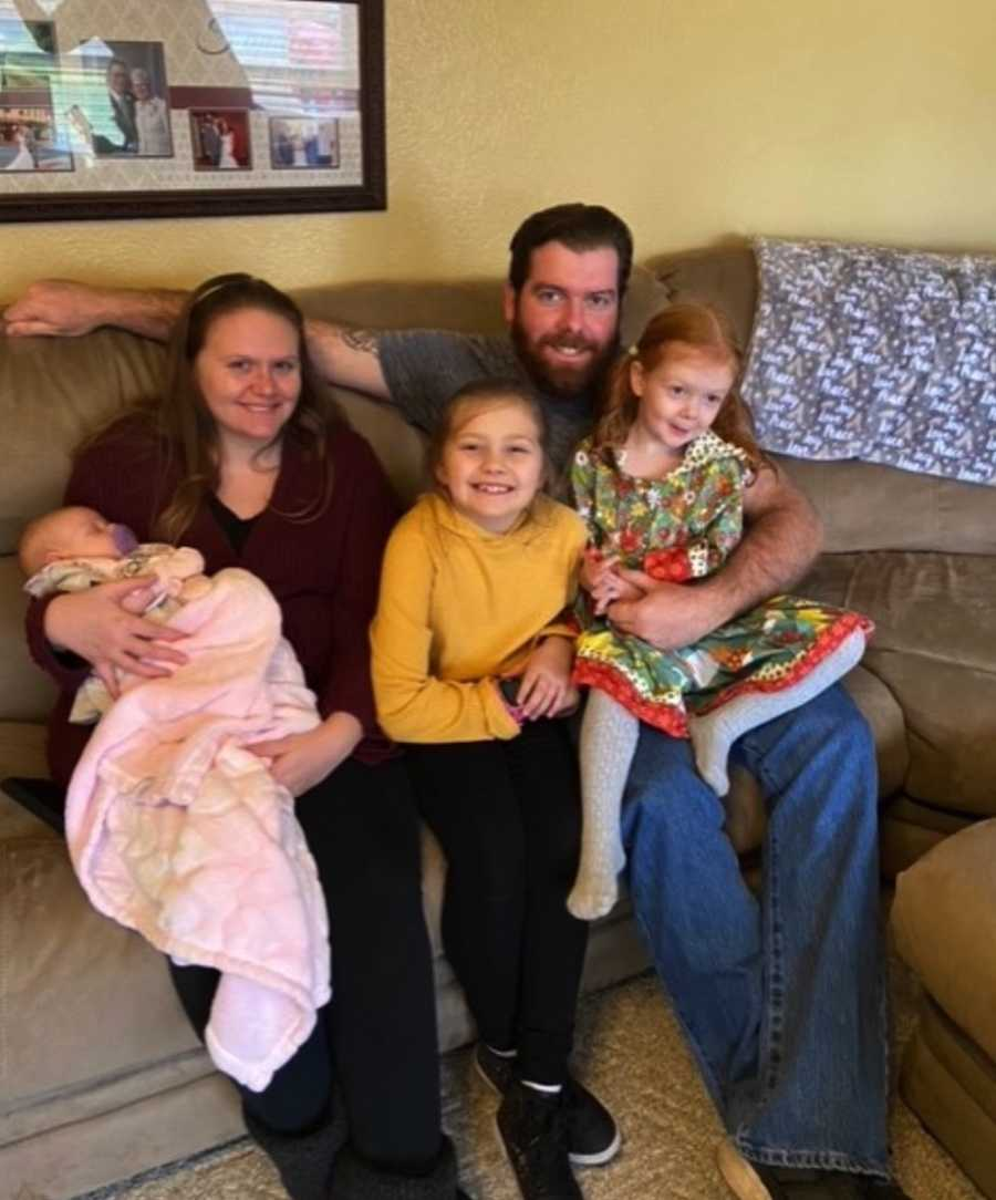 Family photo with daughters and newborn