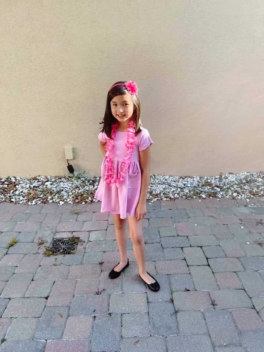 Little girl sassily poses for a photo in all pink floral outfit