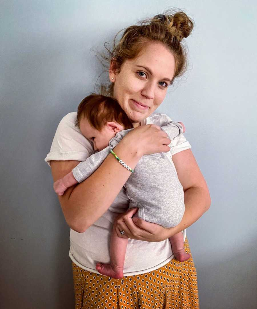 Mother holding newborn baby