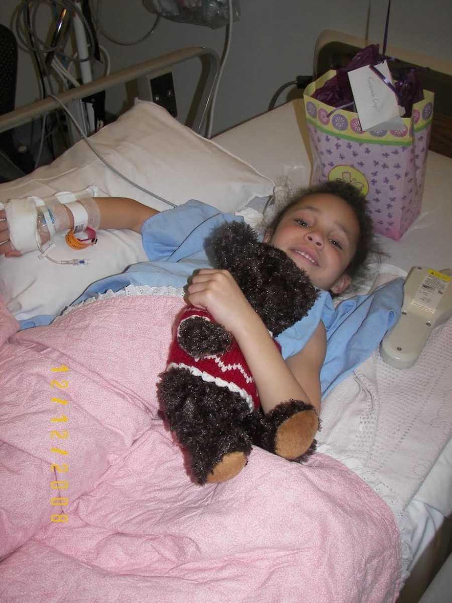 Little girl in the hospital holding teddy bear