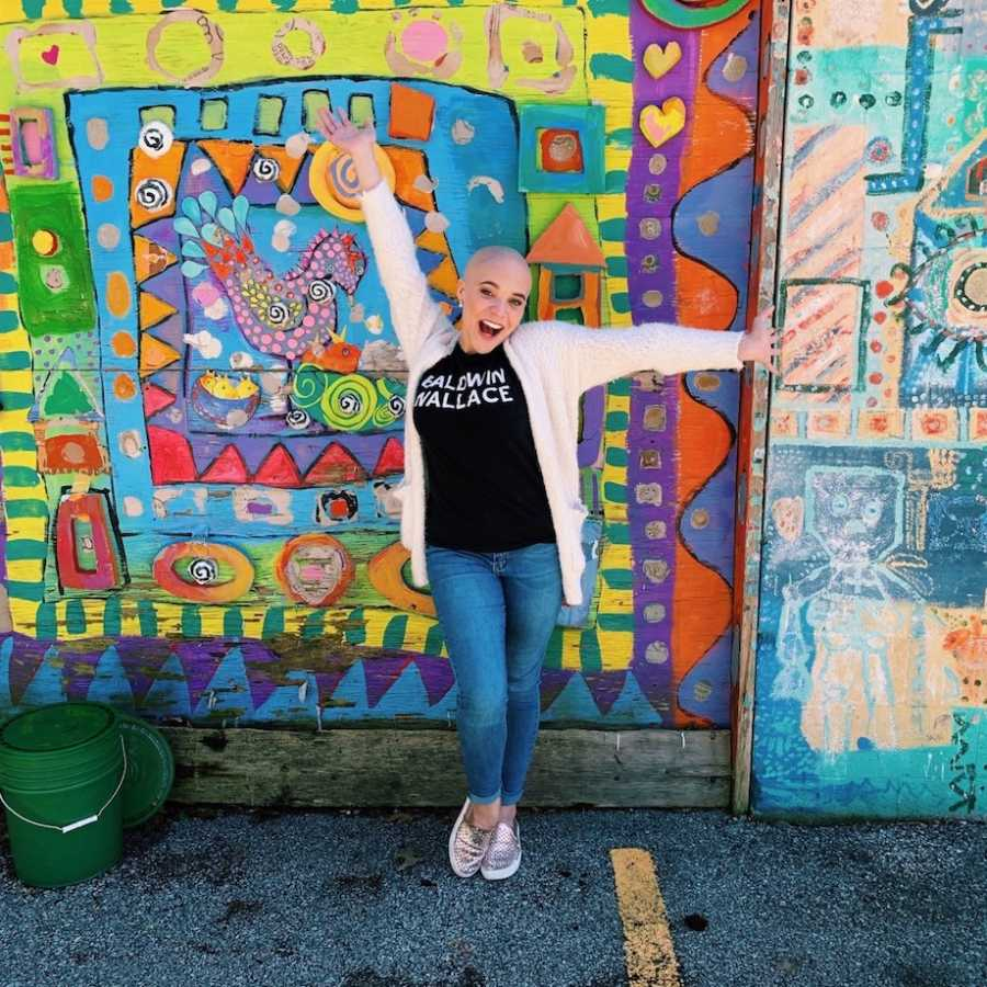 Woman posing in front of colorful background