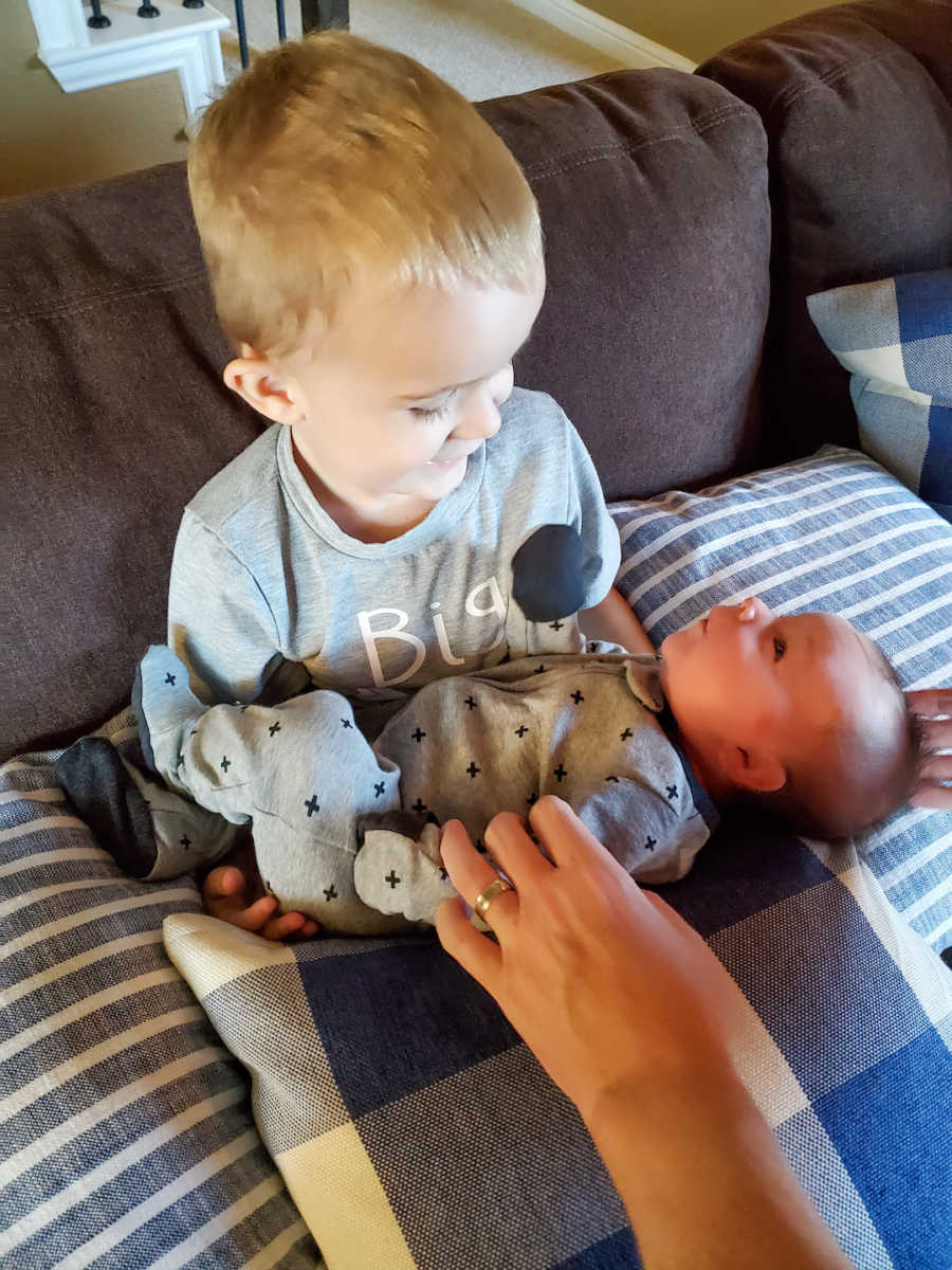 young boy holding younger brother