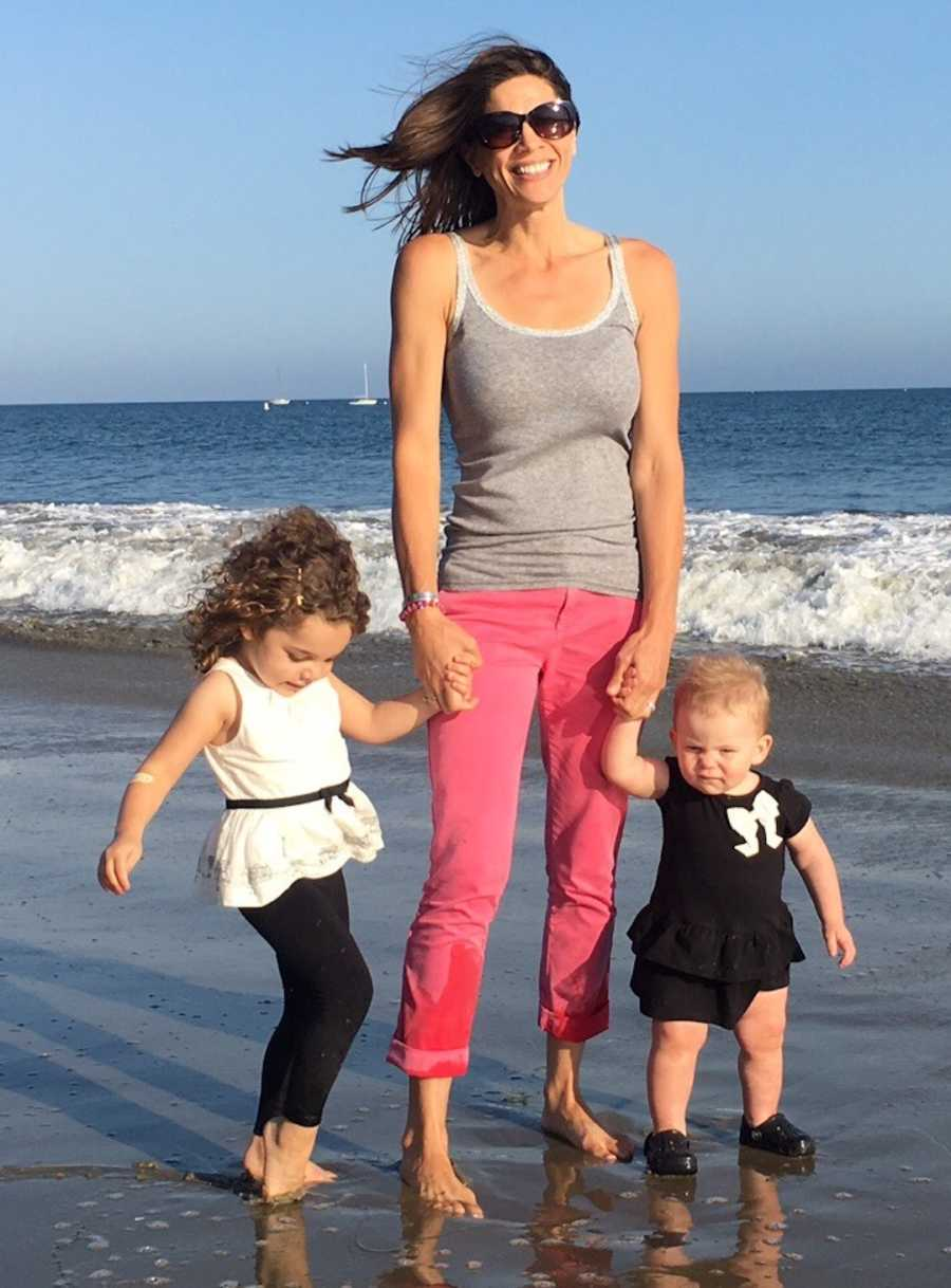 mom and her two daughters on beach