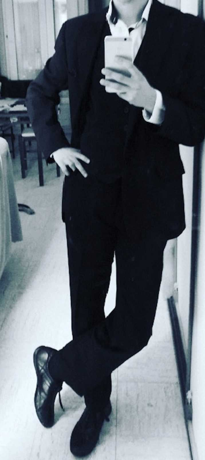 transgender woman in a suit