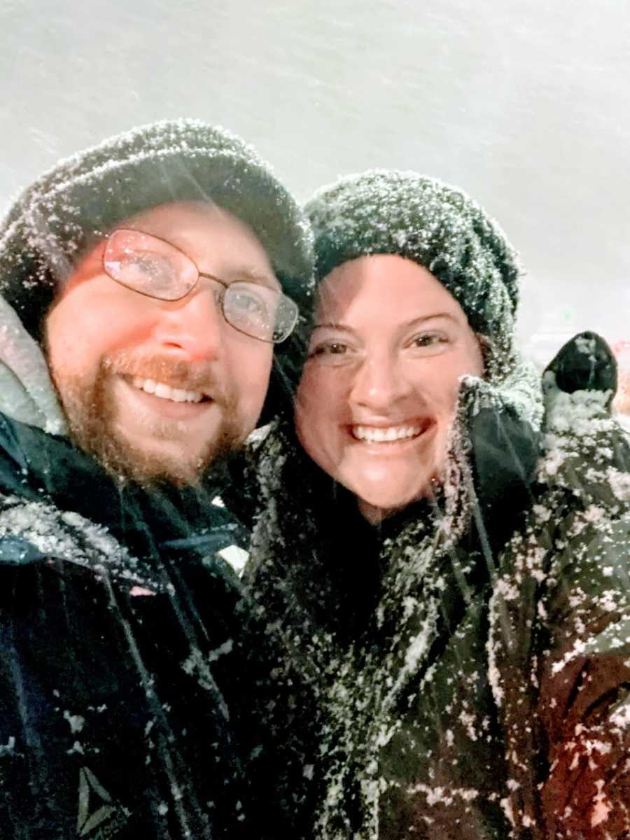 Married couple take a selfie out in the snow during a snowstorm