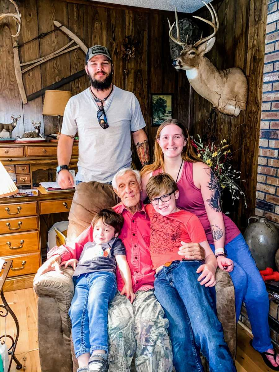 A disabled woman and her family pose with her grandfather
