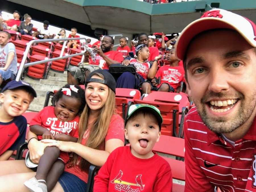 Family sitting in stands at Cardinal's baseball game