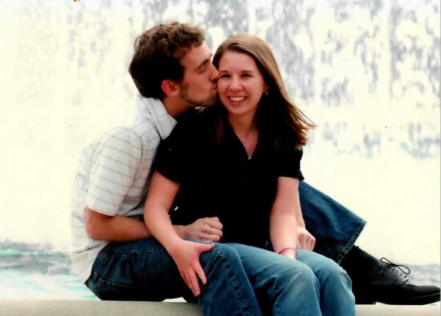 Newly engaged couple smiling