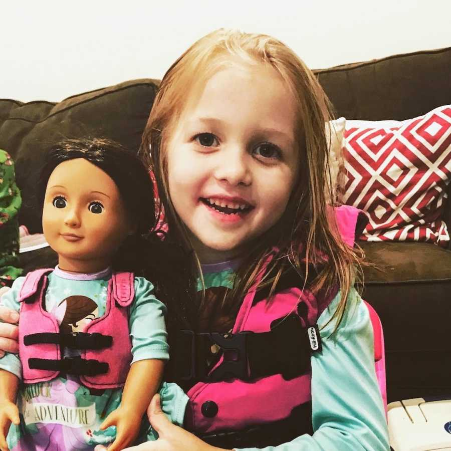 Baby girl wearing cystic fibrosis vest with matching doll