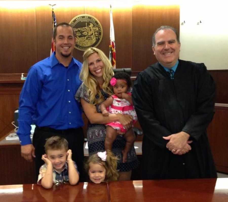 family in courthouse after adoption