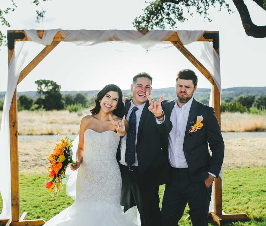 Bride in wedding gown with two men in tuxedos