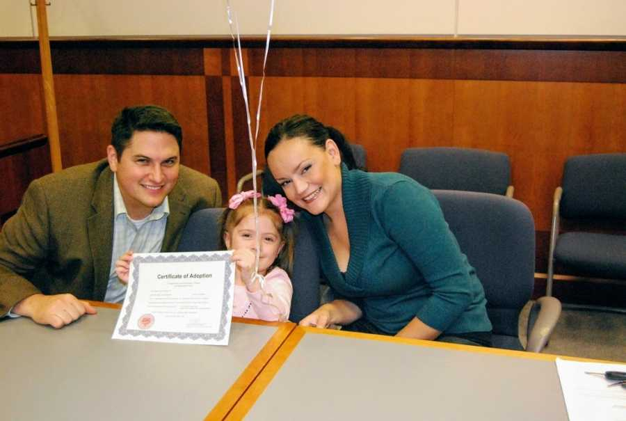 Adoptive parents and daughter on adoption day