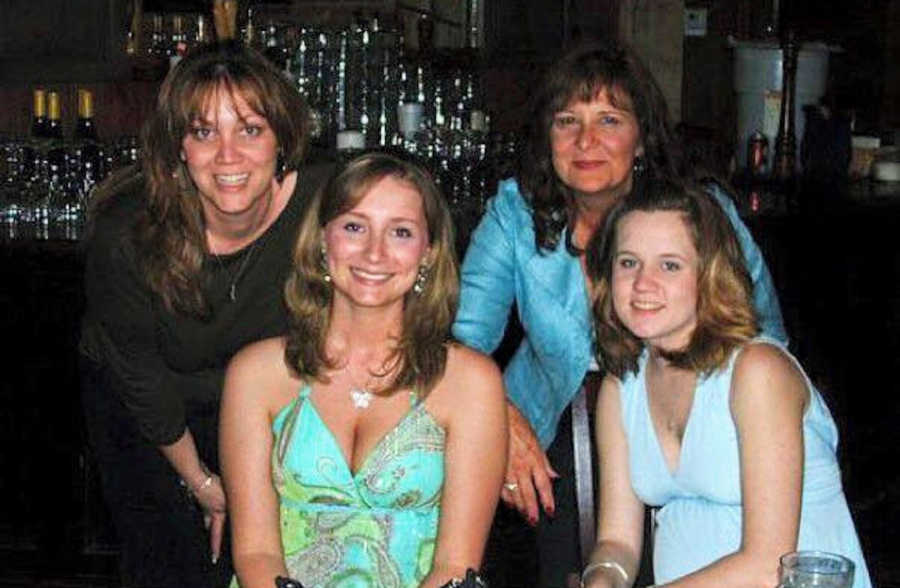 Group of four girls smiling at a bar