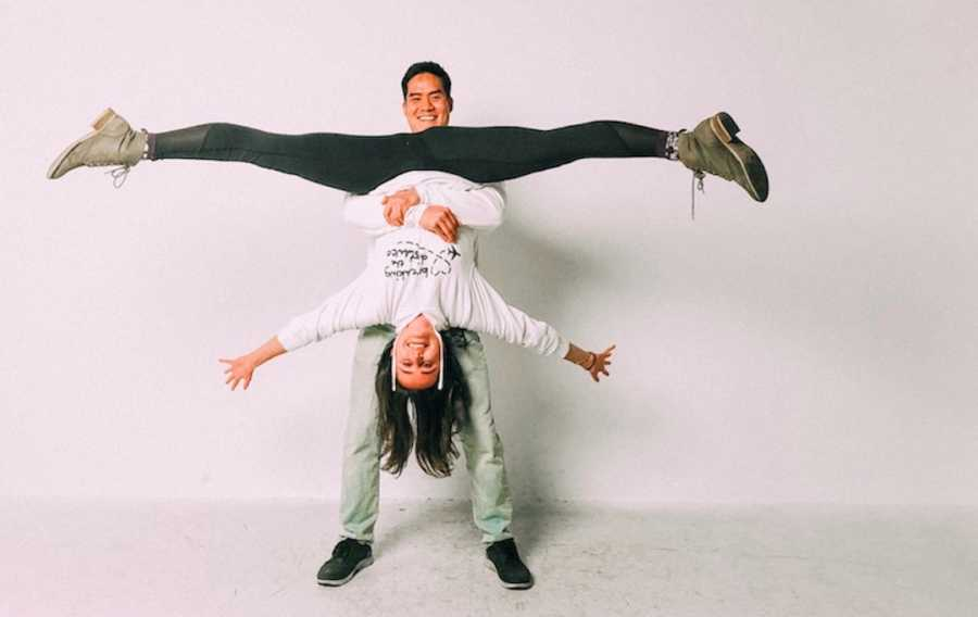 Man holding woman upside down and smiling