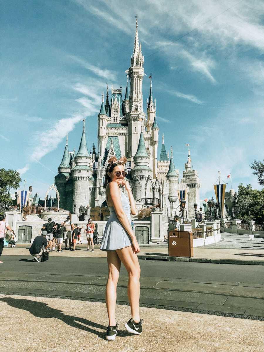 Young woman wearing sunglasses at Walt Disney World