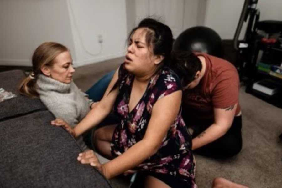 woman in labor with doula