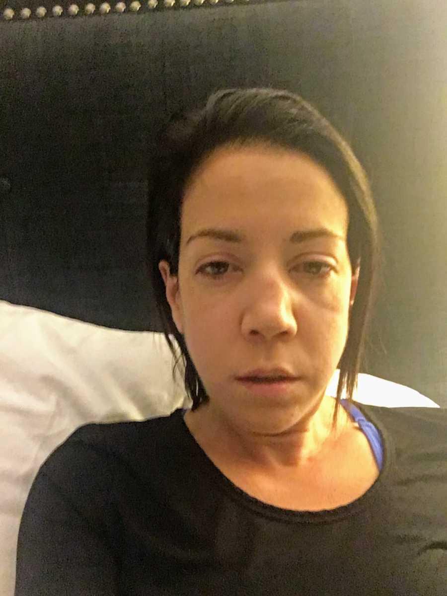 Woman wearing black lying in bed