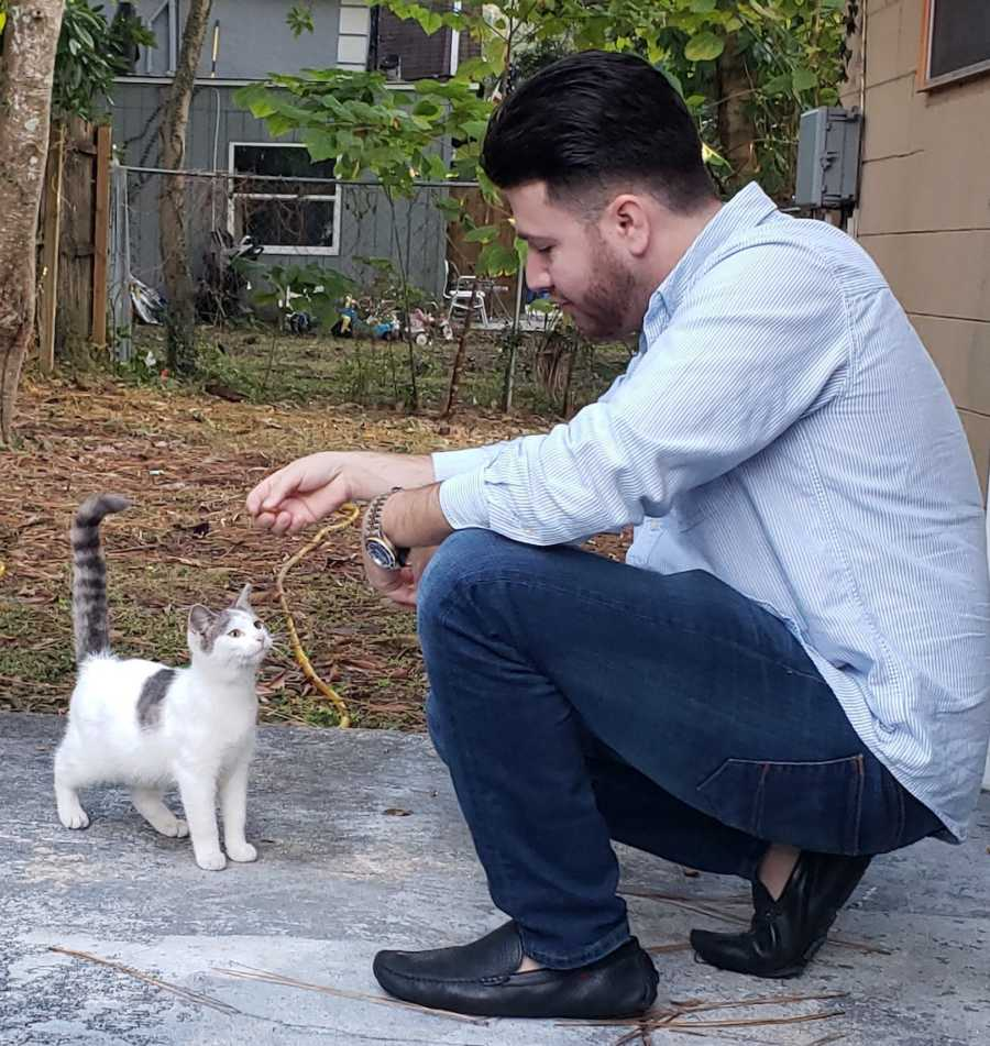 man with a cat