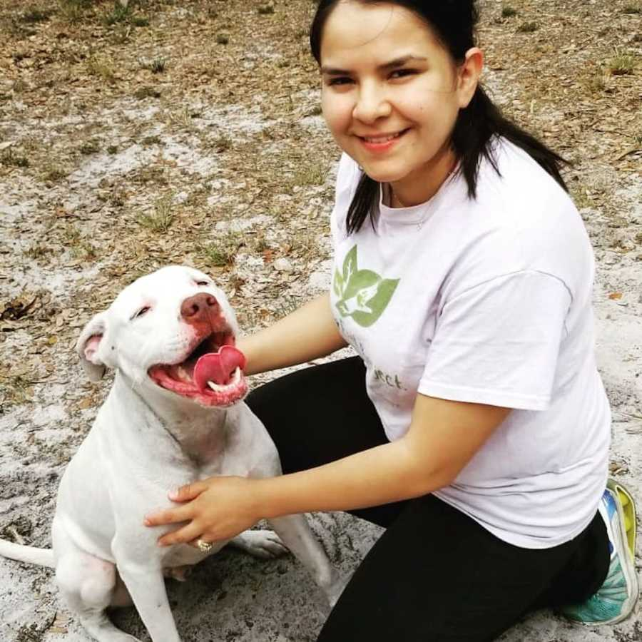 smiling girl posing with a dog